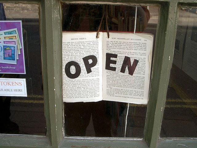 An open sign that is an actual book. That is amazing!