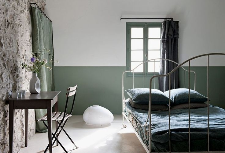 Two toned green white walls in a bedroom with white iron bed. http://cococozy.com