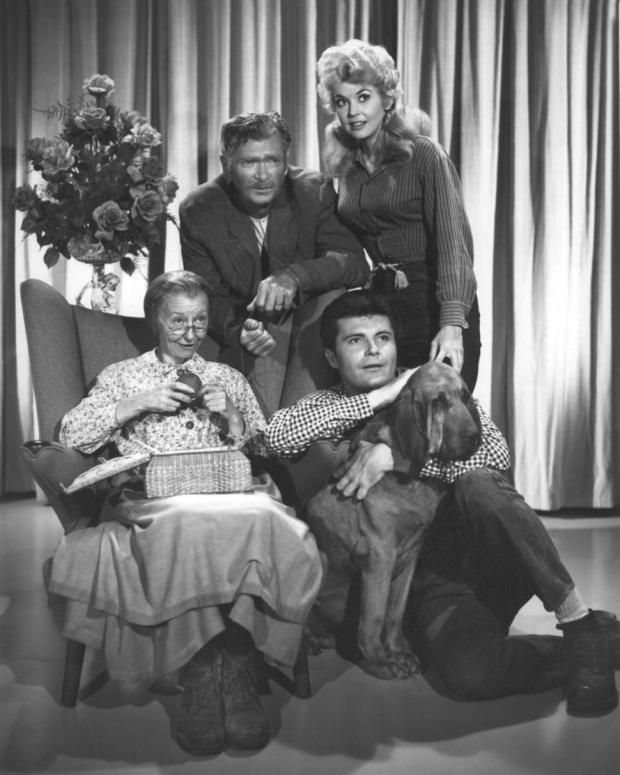 Members of the cast of the TV series 'The Beverly Hillbillies' in a publicity still, circa 1965. Clockwise, from left: Irene Ryan (1902 - 1973), as Granny Daisy Moses, Buddy Ebsen (1908 - 2003) as Jed Clampett, Donna Douglas as Elly May Clampett and Max Baer Jr. as Jethro Bodine.