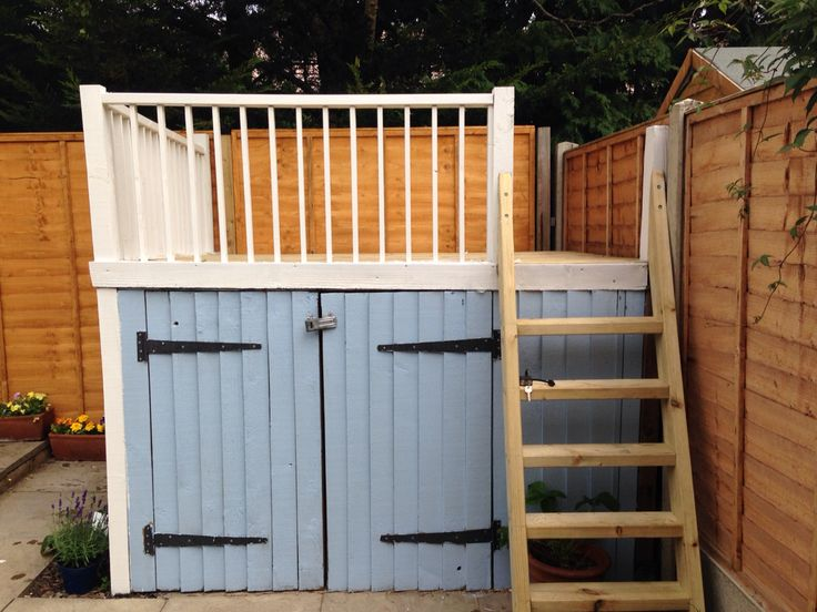 Our shed project is complete. The kids use it as a stage, a pirate ship, a picni...