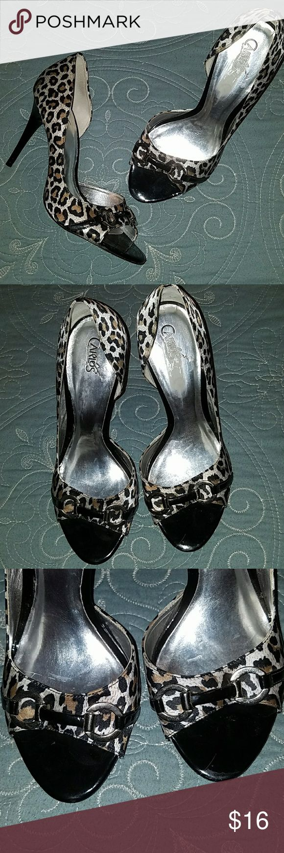 Carlos Santana leopard high heels These cute shoes are in amazing condition material is satin upper. Smudges on the inside of the shoe were from where I tried to take off the sticker adhesive and does not affect the quality of the shoe in any way. Carlos Santana Shoes Heels