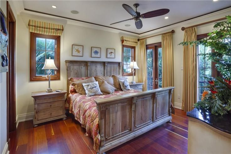 "Craftsman Master Bedroom with St. James Panel Bed with Footboard, St. James 32"" Closed Nightstand, French doors, Ceiling fan"