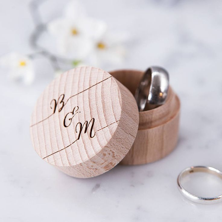 A wonderfully personalised wedding ring box, for storing the all-important precious accessory, on the big day and beyond.  This wooden ring box is hand crafted from solid wood and created just for your occasion, with engraved detail on the circular cover.  The featured box displays the couples bespoke initials and ampersand and is ideal as a wedding or engagement gift, keepsake, or accessory for the happy couple to commemorate the start of their journey together.  Make sure to view our…