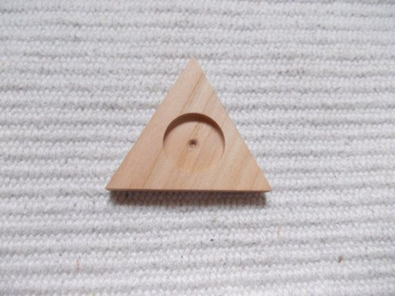 1 p unfinished wooden triangle brooch/pendant/pin base with 20 mm cutout,wooden triangle resin tray,brooch setting,triangle jewel supply  1 piece unfinished triangle cheer/ plywood/dark walnut wood jewel base/frame for jewel making. It is perfect size to make brooch, pins or pendant. In the middle of the pendant base there is a 20 mm cutout, where you can put a 20 mm glass cabochon. https://www.etsy.com/listing/171221767/1-p-unfinished-wooden-triangle?ref=related-1
