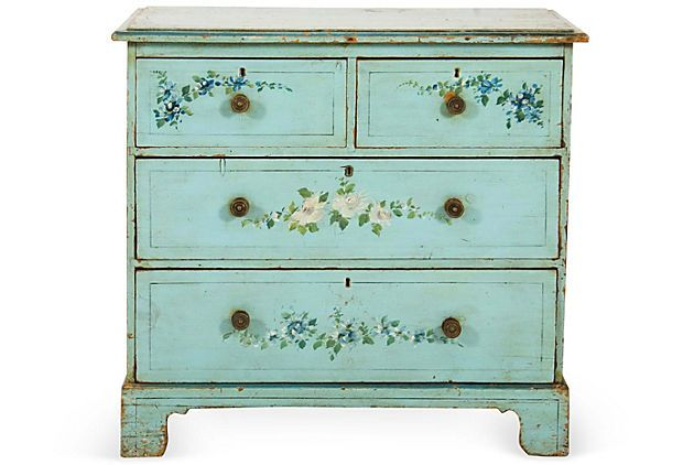 "Small chest of drawers painted light blue with flowers motif. Four drawers with brass knobs, on bracket feet, circa 1900; 34""L x 17.5""W x 31""H."