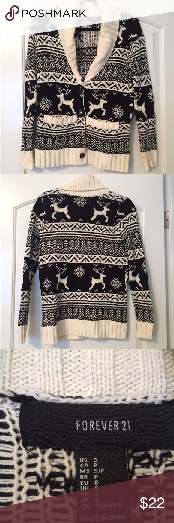 Forever 21 Christmas Cardigan Size S This is a Forever 21 knit button up cardigan with a black and white reindeer Christmas pattern. It is a size Small. Never been worn. Smoke free home. Forever 21 Sweaters Cardigans