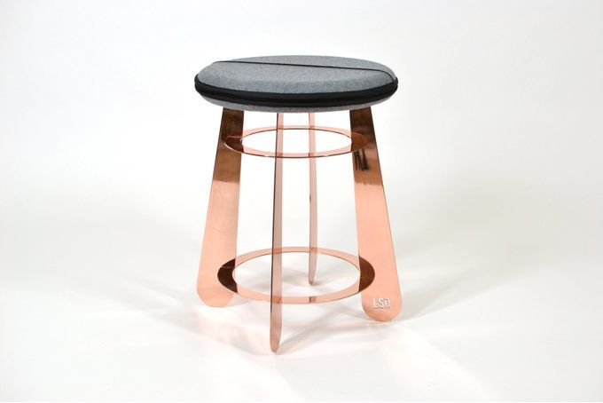 The Soft Stool features a luxurious polished copper (plated) structure and a seat upholstered in a hard-wearing grey felt.