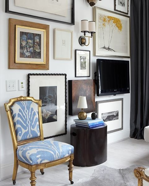 Chair powder blue Ikat upholstery, gold framed chair, gallery wall