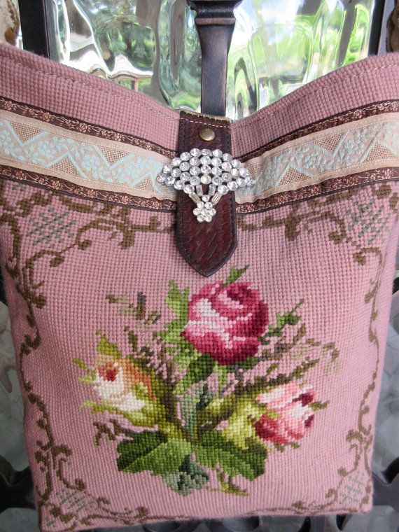 Roses on rose! A bouquet of sweet roses on a rosy pink background are the focal point of this vintage needlepoint. Exquisite french aqua and taupe