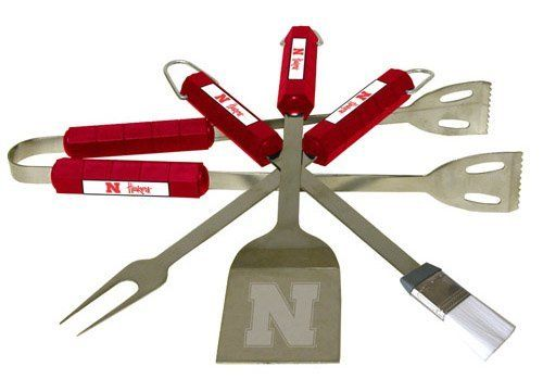 Nebraska Cornhuskers 4pc BBQ Set by BSI. $43.99. Tailgating never looked so good! This stainless steel BBQ set is a perfect way of showing your team pride on Game Day. Each utensil is printed with your favorite College team's artwork. The set includes tongs, brush, fork and a laser etched spatula.