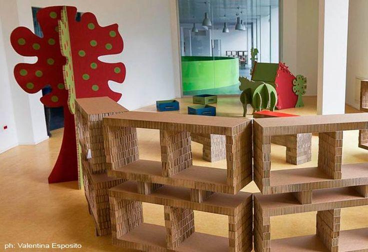 Nursery design ideas, children corners design ideas, cardboard shelves, cardboard benches, magical cardboard apple trees, Biblioteca Chivasso