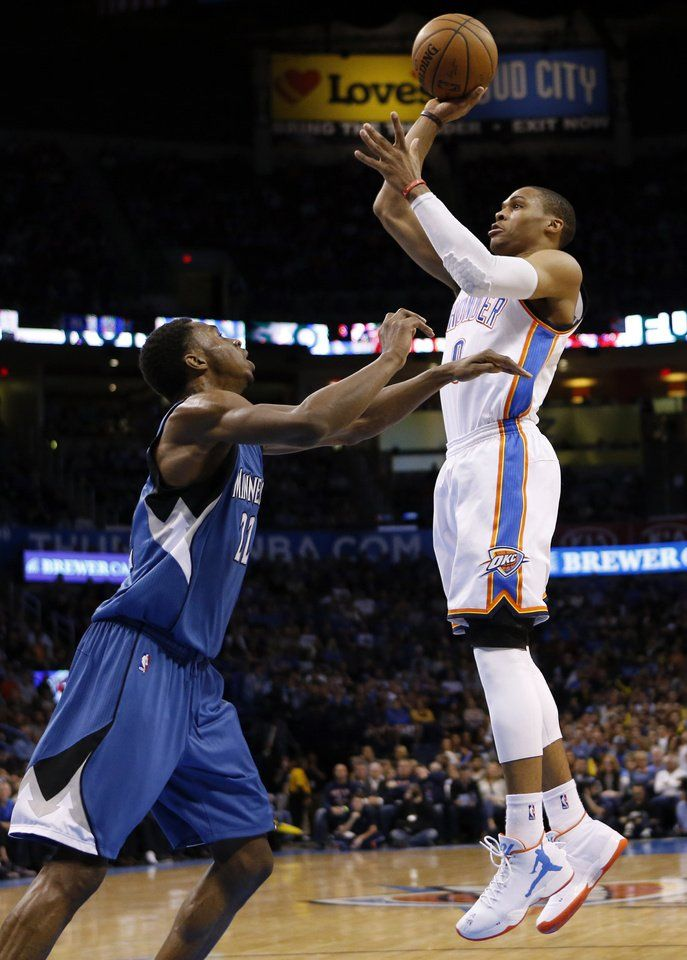 Oklahoma City's Russell Westbrook (0) shoots over Minnesota's Andrew Wiggins…