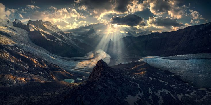 A lone figure stands in the distance in the incredible landscape photographs. Image by Max Rive/International Landscape Photographer of the Year