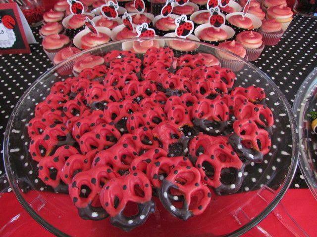 Red and black chocolate dipped pretzels from a Ladybug Party #ladybug #pretzels