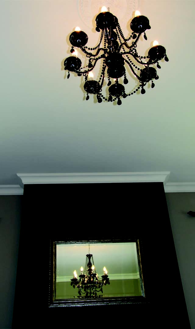 Ornamental lighting and feature mirror in the living room.