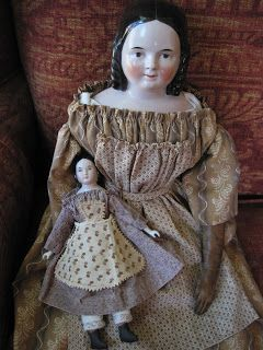 Stunning china head doll with a Lydia style hairdo, c. 1840's/50's, leather hands.