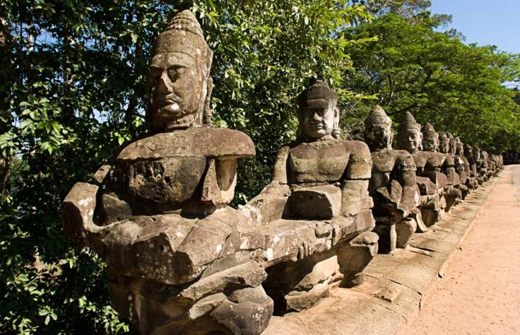 The causeway at Angkor Thom consists of a row of statues pulling on the Serpent King