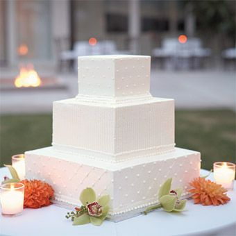 Brides: White Square Wedding Cake with Dots. The stark, modern cake, created by Exquisite Desserts in Palm Desert, was frosted in white buttercream and served with fresh blueberries.