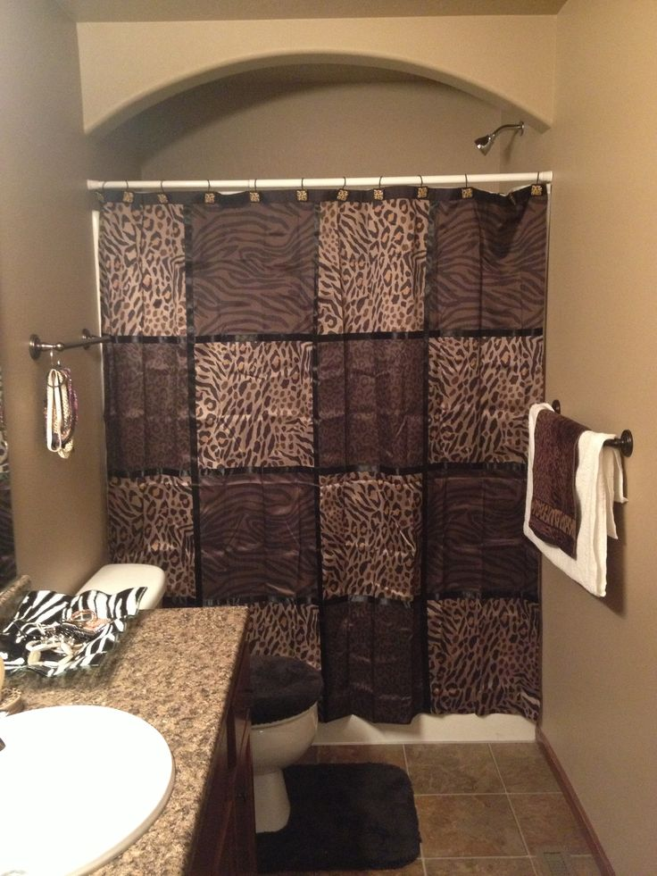 Bathroom brown and cheetah decor. Love this!
