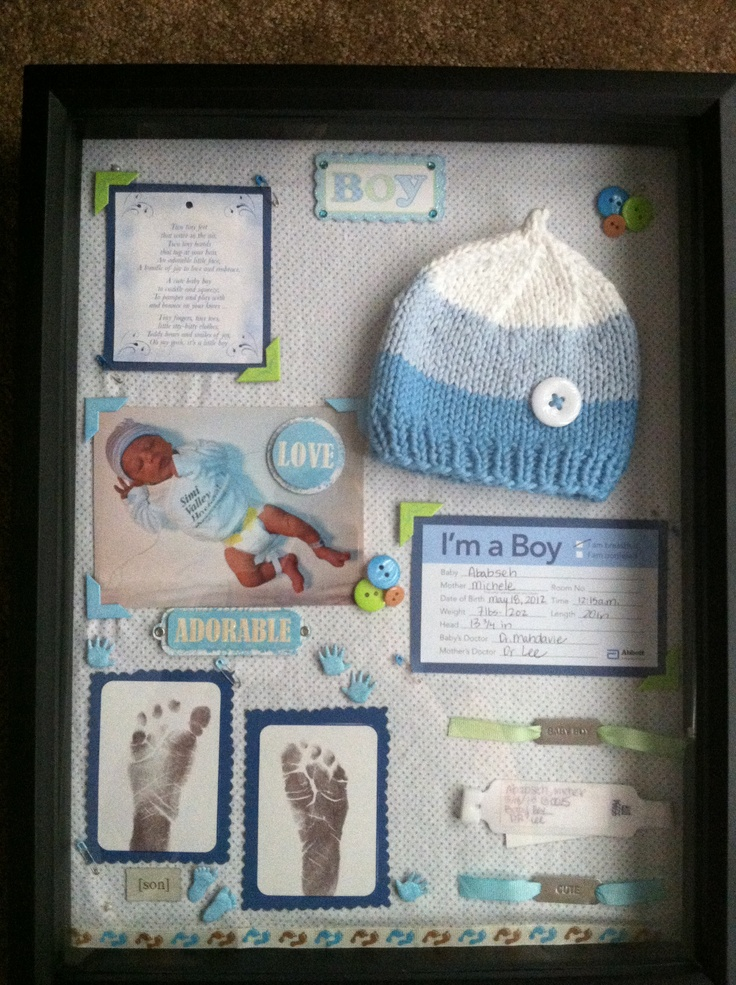 Baby boy shadow box! I used his baby blanket as the background, all the goodies from the hospital, the BOY sticker from my baby shower invites, scrapbooking embellishments. Love my baby boy! Now I have all his baby stuff to keep and look back on forever!--Like the buttons, and the pic (since I don't have the going home outfits)