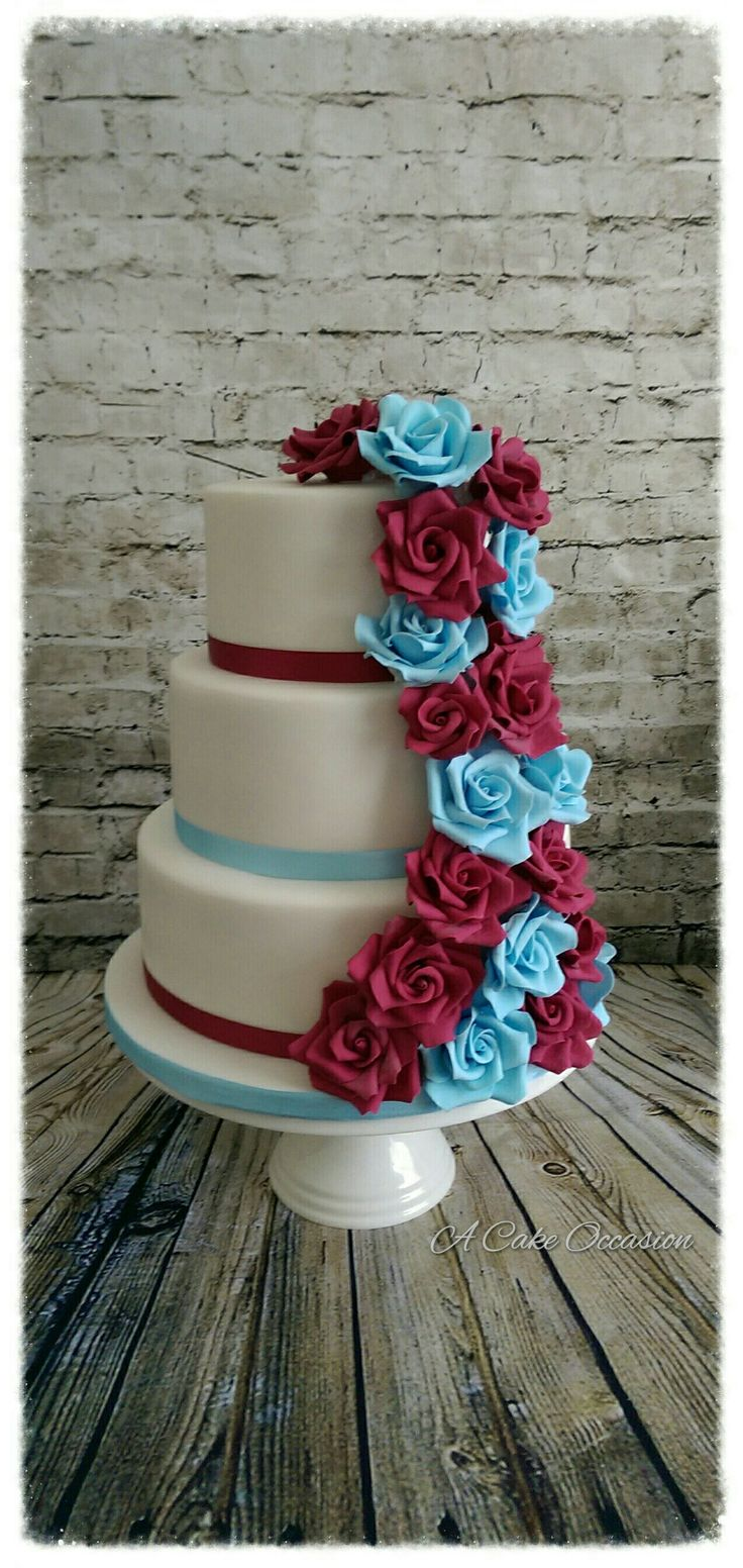 Cascading roses wedding cake im claret and blue