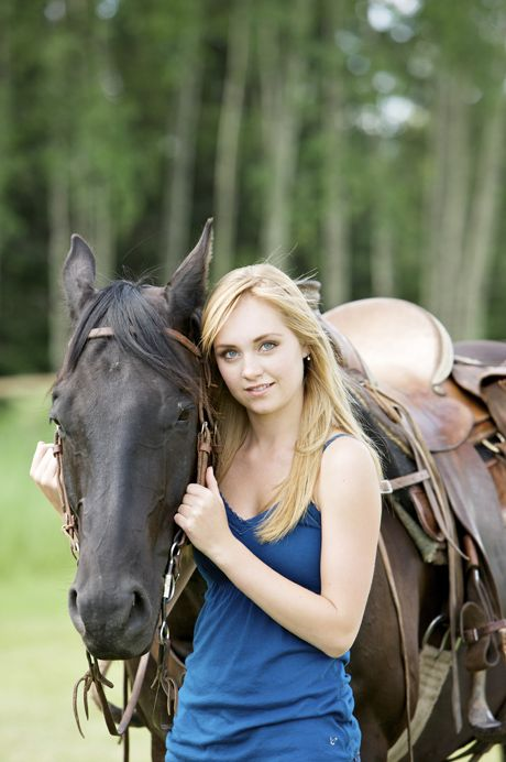 This is photograph of Amber Marshall as Amy Fleming from Heartland. Amber with Spartan from Heartland.