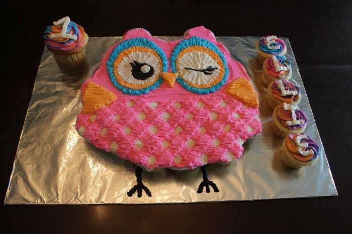 I mentioned a few weeks ago that we had an owl cupcake cake in the works.  Well… here it is! This project was based off of the plates and napkins that were going to be at the party.  Here are some pictures sent to me from our customer. The most fun part of this project …