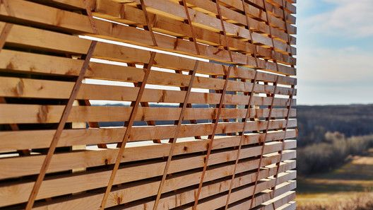 Wooden panel system. Slats are connected by timber battens on 45°angles—front and reverse. The battens act as structural elements limiting the size and quantity of mechanical fasteners. Image © Peter Lawrence