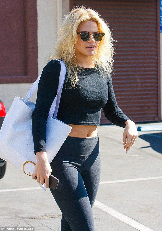 Ab-tastic: Witney Carson displayed her taut tummy in a black crop top following rehearsal