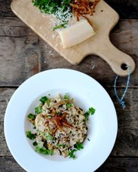 Dried-Porcini-Mushroom Risotto with Goat Cheese | Using the mushroom-soaking liquid to cook the rice gives this risotto intense flavor. There's just enough goat cheese to balance the earthiness of the porcini with a touch of tartness without overwhelming the dish.