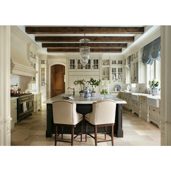 Kitchen features creamy slightly glazed cabinets, a large black island and Calcutta Gold marble countertops Butlers pantry is painted Java (…the darkest stain available) with Calcutta Gold marble countertops