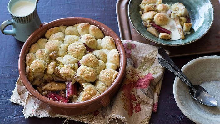 Dating back to the early British settlers of North America, cobblers are based on seasonal fruits and topped with a wet, scone-like mixture. @annekamanning recipe stars pear and rhubarb. #Bakeproof