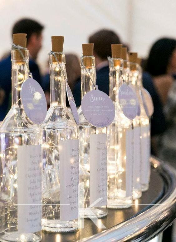 Table plan inspiration - Quirky wine bottle table plan idea.
