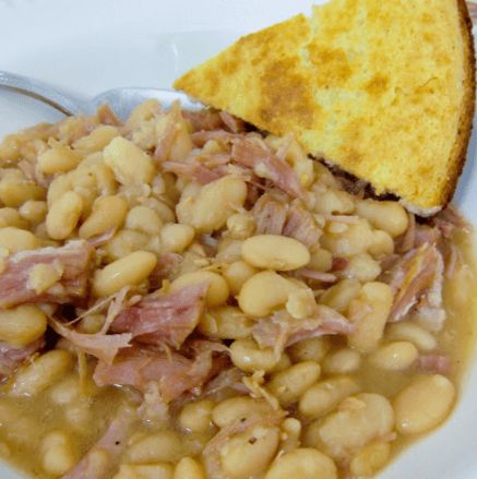 This is the last recipe from our Christmas ham.  I always look forward to finishing off the ham with a nice big bowl of white beans and slice of cornbread.  This recipe is super simple.  It