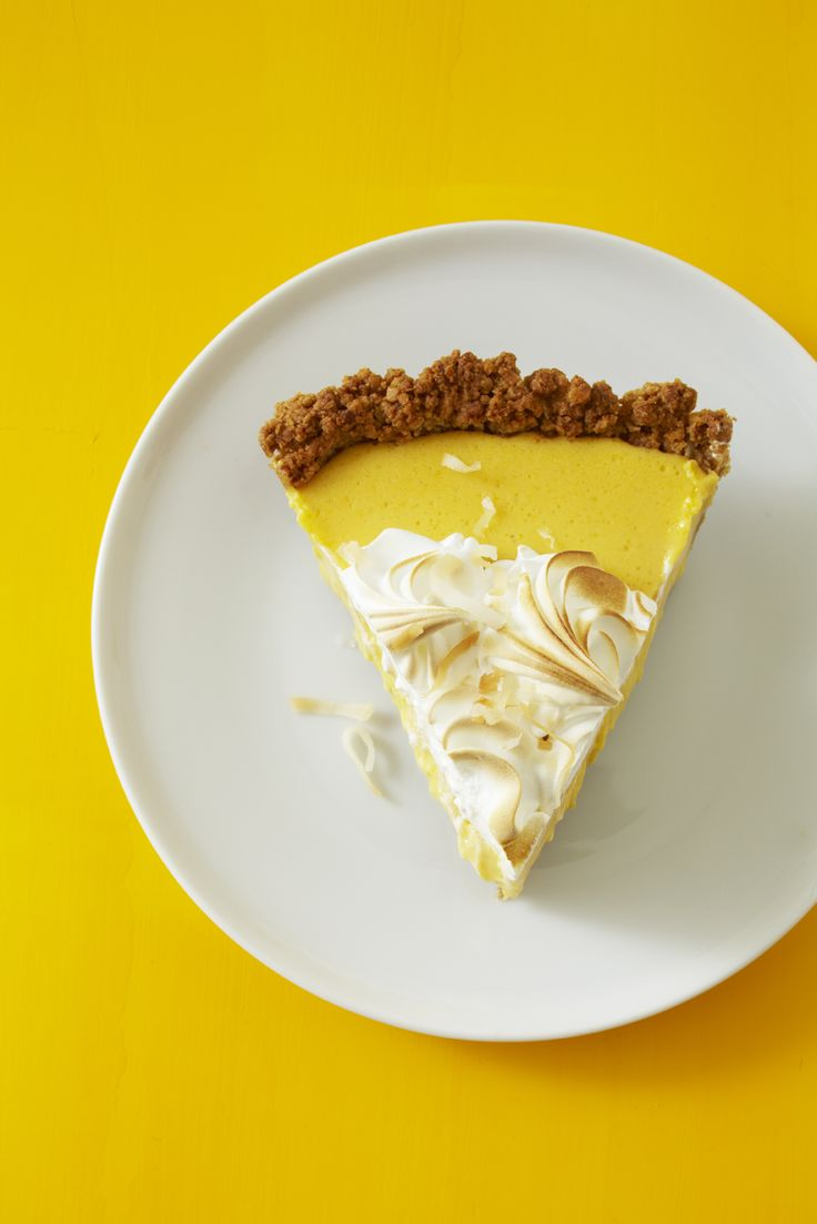 Intensely fruity and creamy mango filling is baked into a toasty coconut graham crust then piped with Swiss meringue.