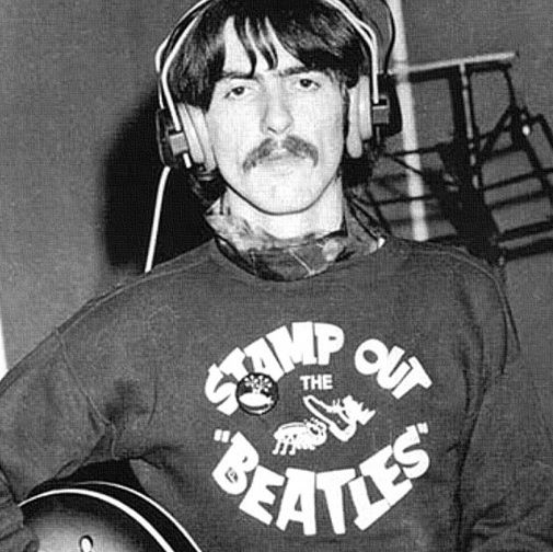 "Classic Photo: George Harrison wearing a ""Stamp Out The Beatles"" sweatshirt  #georgerharrison #thebeatles"