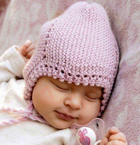 Вязаная шапочка для новорожденного спицами
