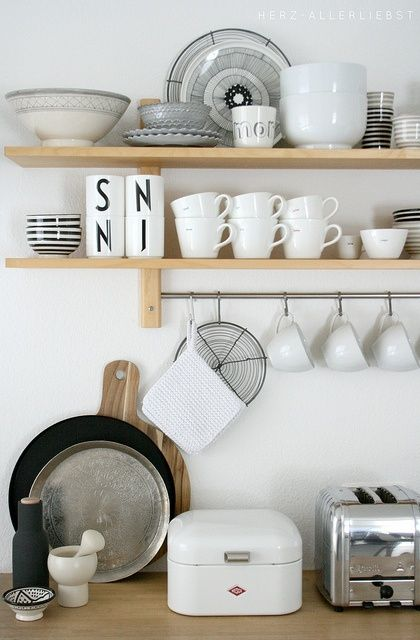 White dishes make it easy to add to. Love the mix of Marimekko plates and cups from Design Letters.