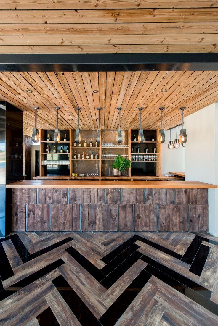 Inhouse Brand Architects executes a modern design for Anura Vineyards' new events venue and bar. #interiordesign #interiors #elegantinteriors #sophisticatedinteriors #eventsvenueinteriors #winefarminteriors #winefarms #southafricanwinefarms #beautifulspaces #bars #barinteriors