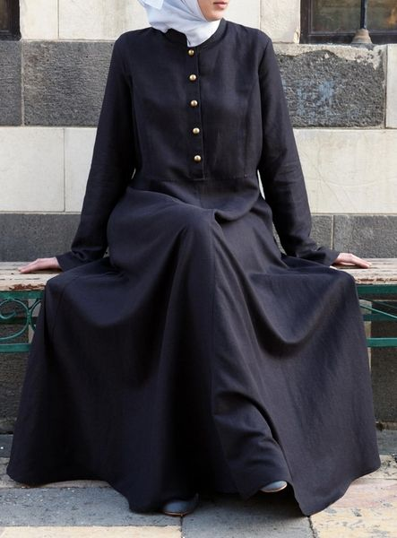 One of our favorite pieces and silhouettes for spring, the Ubayda Abaya is effortlessly chic and easy to wear. In addition to the flattering cut, the clean lines, beautiful buttons and practical pockets all work together for a unique and refined look. A great day-to night piece, this will surely be a wardrobe must-have. Note: This product requires 3 working days processing time before it is shipped.