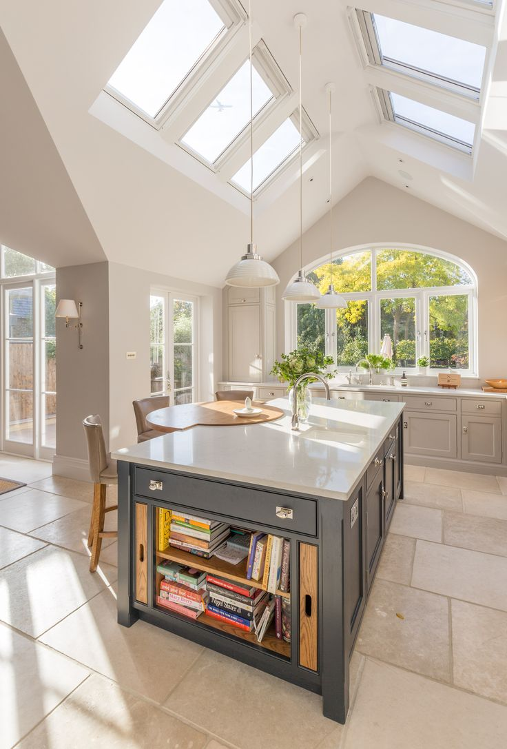 Kitchen island | breakfast bar seating | island storage | Limestone floor | pitched roof extension | feature arch window | sink on island | London