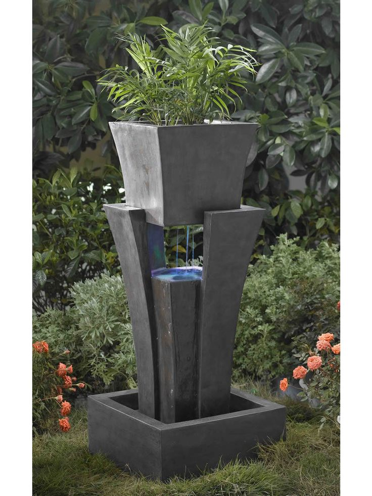 A far cry from classical, the Modern Shape Water Fountain with Planter is a uniquely shaped water feature that brings the element of a plant together with water. Water dances from below the planter in