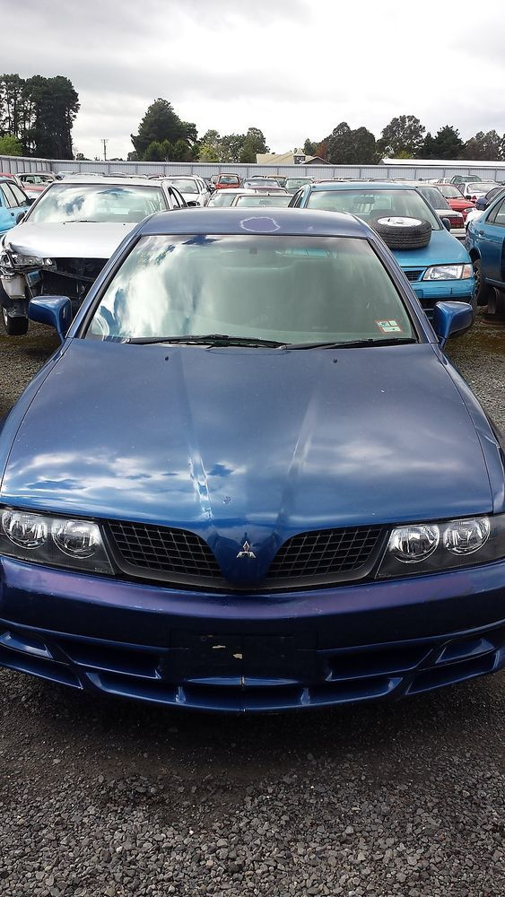MITSUBISHI MAGNA VRX 02 FOR WRECKING - MOST PARTS AVAILABLE (BID WHEEL NUT ONLY)