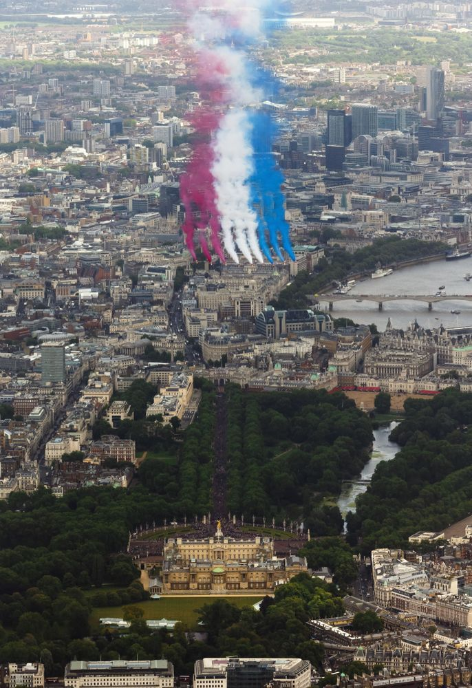 The RAF Red Arrows perform a flypast over Buckingham Palace, central London, following the Trooping of the Colour. 15 June 2013