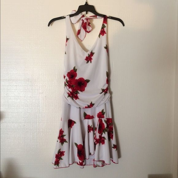 Speechless Red Floral Dress Red Floral dress by Speechless. Great condition. No tag but fits like a XS. Bust measurement is about 15 inches across. Waist area is roughly 26 inches. Speechless Dresses