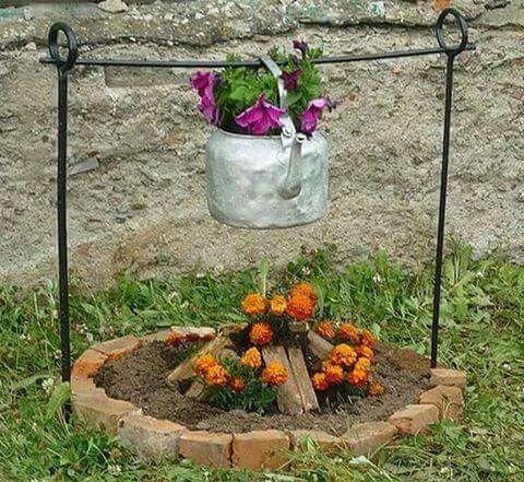 Creative garden kettle over a fire