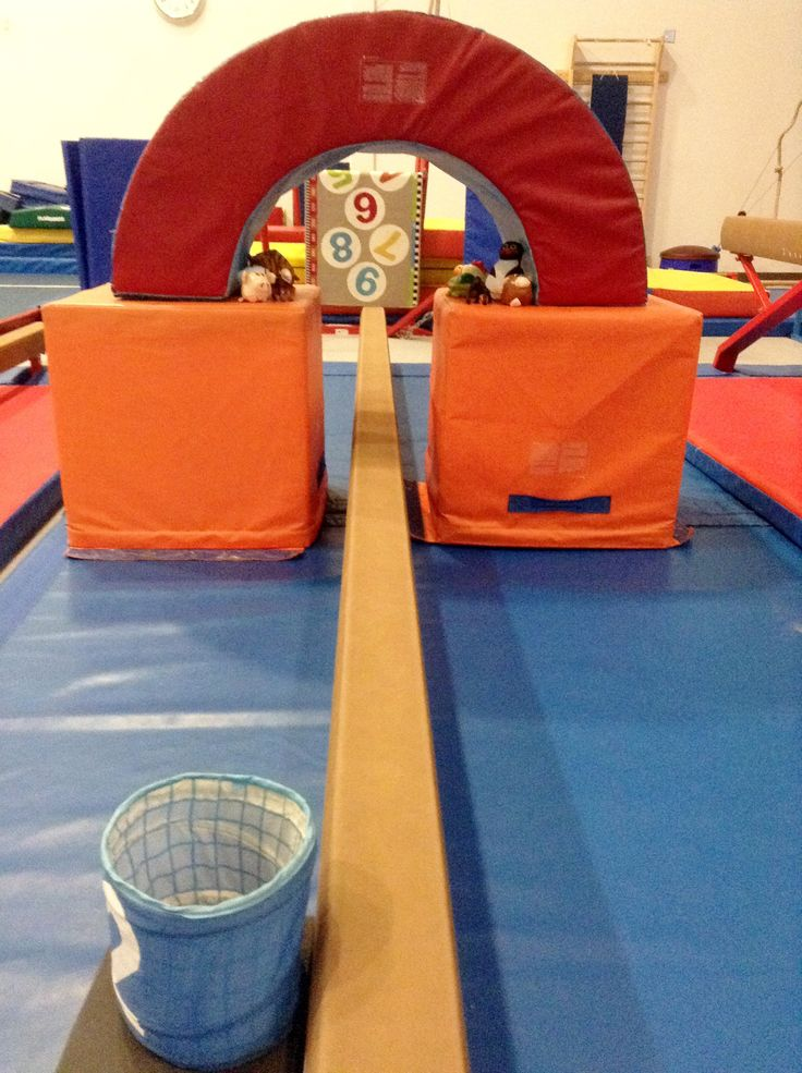 """SUPERHERO THEME WEEK! As kids go under the bridge, they needed to """"rescue"""" one of the animals trapped underneath and bring them to the safety spot (the bin).  www.recgympros.com  #gymnastics #preschoolgymnastics #kindergym #recgymnastics #superhero #themeweek"""