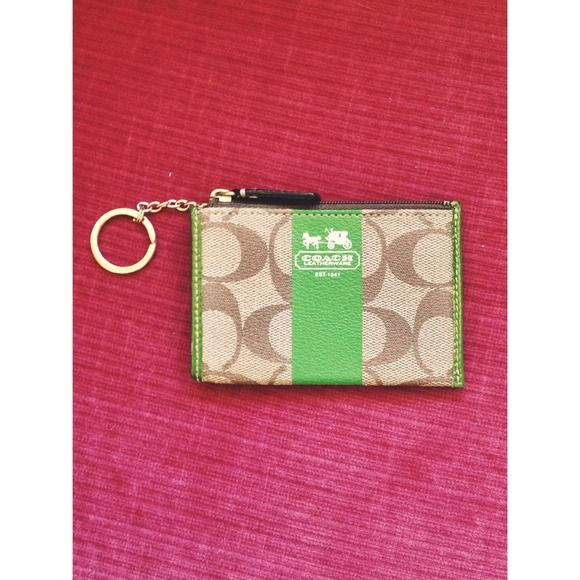 Small Coach Wallet/key chain Perfect condition with optional key ring (can be tucked inside) back of wallet has small pocket 100% authentic Coach Bags Wallets