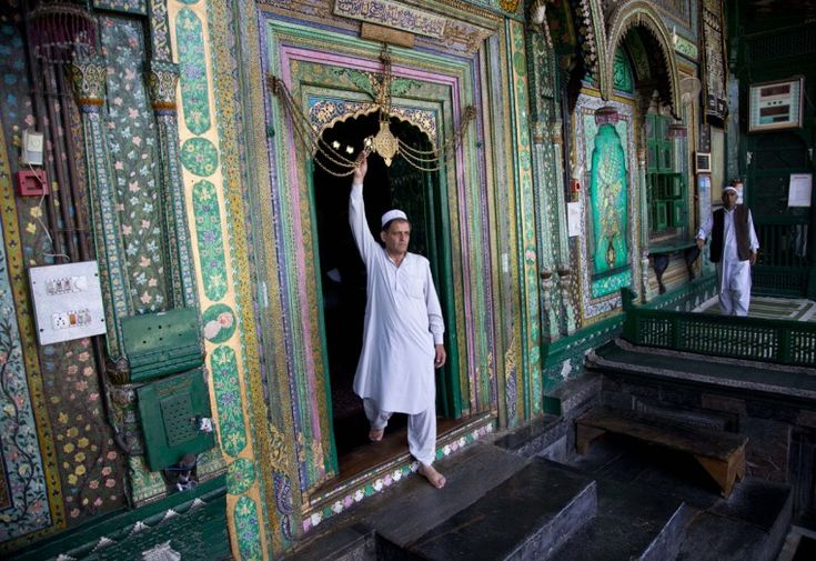 A Kashmiri Muslim man touches in reverence a chain at the entrance to the shrine of Shah Hamadan on the first day of the holy month of Ramadan in Srinagar, Indian controlled Kashmir, Friday, June 19, 2015. Muslims throughout the world are marking the month of Ramadan, the holiest month in the Islamic calendar during which devotees fast from dawn till dusk. (AP Photo/Dar Yasin)