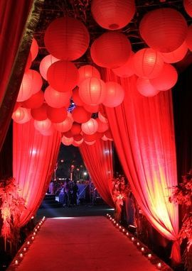 Red Theme Entrance Decor | WedMeGood Beautiful Red Carpet Entrance, With Red Hanging Lamp Shades and Curtain Drapes. Find many more inspirations on wedmegood.com #wedmegood #wmgdecor #wmgred
